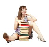Student sitting with pile of books Royalty Free Stock Image