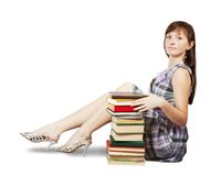 Student sitting with pile of books Stock Photos