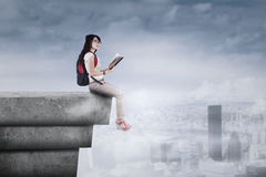 Student sitting on the rooftop Stock Photography