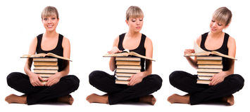 Student is sitting with stack of book Royalty Free Stock Images