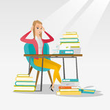 Student sitting at the table with piles of books. Stock Photo