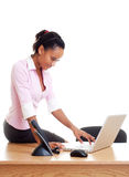 Student sitting on the table and typing Stock Image
