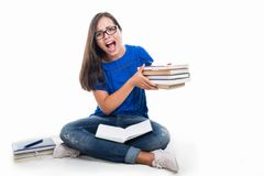 Student sitting taking bunch of books and screaming Royalty Free Stock Images