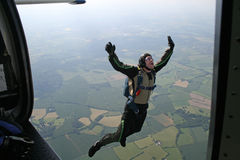 Student skydiver jumps from an airplane. High up in the air Stock Image