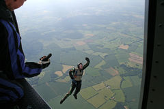Student skydiver jumps from an airplane. High up in the air Stock Photos