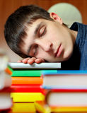 Student sleep on the Books. Tired Teenager sleep on the Books at the Home Stock Image