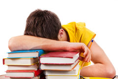 Student sleep on the Books. Tired Young Man sleep on the Books Royalty Free Stock Photo