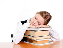 Student sleepin on books Royalty Free Stock Images