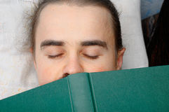 Student sleeping with book Royalty Free Stock Photos
