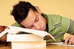 Student sleeping on books Stock Image