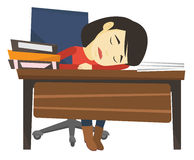 Student sleeping at the desk with book. Stock Image