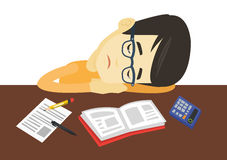 Student sleeping at the desk with book. Stock Photos