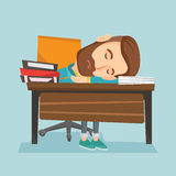 Student sleeping at the desk with book. Royalty Free Stock Photo