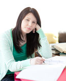 Student sleeping while doing her homework Royalty Free Stock Photos