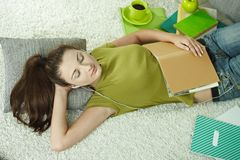Student sleeping on floor Stock Photography