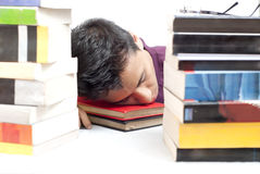 Student Sleeping in Front of Books Stock Photography