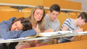 Student sleeping at the lecture hall Royalty Free Stock Images