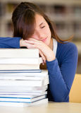 Student sleeping in the library Royalty Free Stock Images