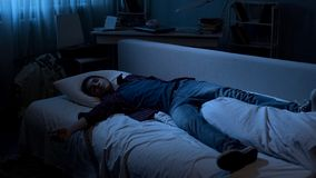 Student sleeping after long day at collage, overworking while preparing for exam stock image