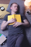 Student sleeping with manual Royalty Free Stock Images