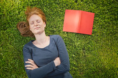 Student Sleeping Next to Textbook Royalty Free Stock Photos