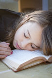 Student sleeping over book royalty free stock image