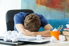 Student sleeping on the table Royalty Free Stock Image