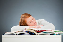Student Sleeping on Textbooks Stock Photos