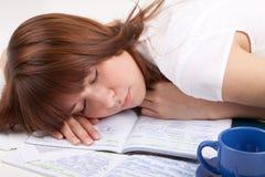 The student sleeps. The girl has fallen asleep on writing-books Royalty Free Stock Photography