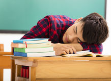 Student sleeps on the desk in classroom Stock Images