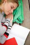 Student sleeps beside open book. On wooden stage,close-up Stock Photography