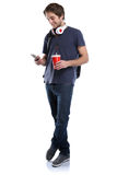 Student with smartphone cola drink young man full body portrait Royalty Free Stock Photography