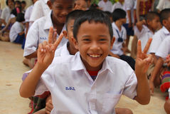 Student smiles with don't give up sign. Student shows fingers sign : Don't give up Stock Image