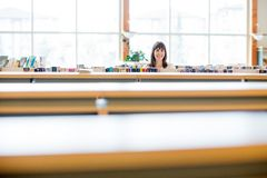 Student Smiling In Bookstore Royalty Free Stock Photos