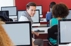 Student smiling at camera in computer class Stock Images