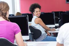 Student smiling at camera in computer class Stock Photos