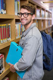 Student smiling at camera in library Royalty Free Stock Photo