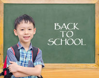 Student smiling in front of chalkboard Royalty Free Stock Images