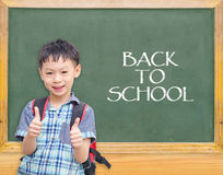 Student smiling in front of chalkboard Stock Photos