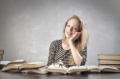 Student smiling happily Royalty Free Stock Images