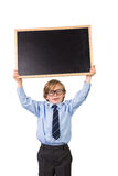 Student smiling and holding blackboard Stock Photo