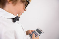 Student smiling and holding calculator Royalty Free Stock Images