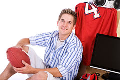 Student: Smiling Man With Ball And Stuff For Dorm Room Royalty Free Stock Photos