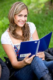 Student smiling outdoors Royalty Free Stock Photo