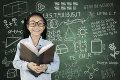 Student smiling with scribble on chalkboard Royalty Free Stock Images