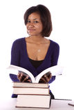 Student smiling with stack of books Royalty Free Stock Image