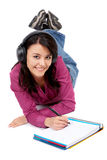 Student smiling while studying Royalty Free Stock Photos