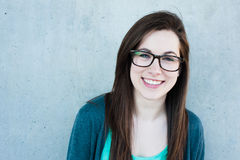 Student smiling. Student woman smiling outside with glasses Royalty Free Stock Images