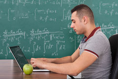 Student Solving Math's Problem On Laptop Stock Image