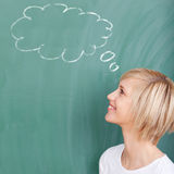 Student with speech bubble on chalkboard Royalty Free Stock Image